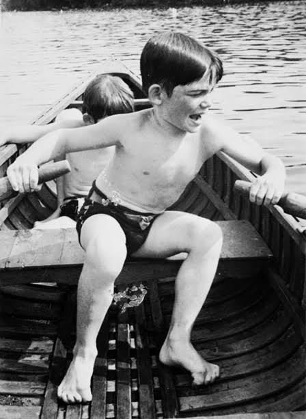 Hemingway's son Gregory 'Gigi' rowing, unidentified boy sitting in canoe behind him. Back of the photograph reads: 'Giggie gets confused when he tries to row.' From the Ernest Hemingway Photograph Collection. John F. Kennedy Presidential Library and Museum, in Boston.