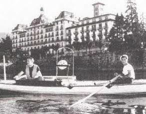 Hemingway rowing in front of Hotel des Iles Borromees