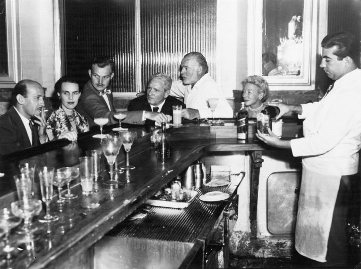 La Floridita, Havana, Cuba. Roberto Herrera, Byra 'Puck' Whittlesey, John 'Bumby' Hemingway, Spencer Tracy, Ernest Hemingway and Mary Hemingway, circa 1955. From the Ernest Hemingway Photograph Collection. John F. Kennedy Presidential Library and Museum, in Boston.