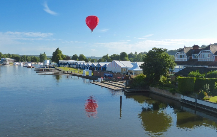 The view downstream from Henley Bridge on Tuesday 28th June, the day before the start of the 2016 Regatta. Leander Club is on the right and to the left of the 'Pink Palace' is the regatta's boat tent area.