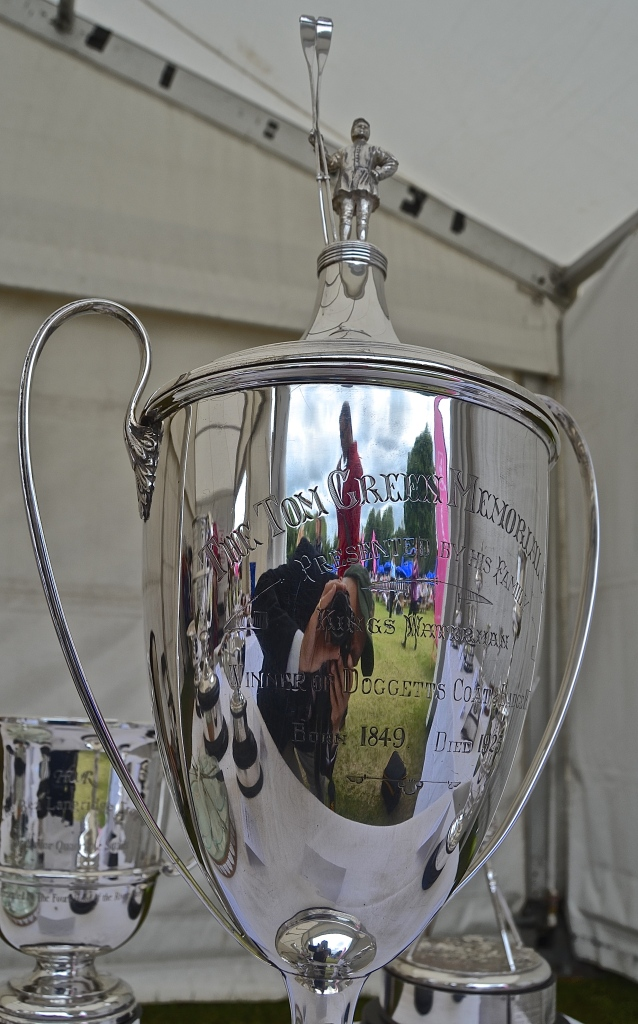 This is now the Nina Padwick Trophy for J16 Quad Sculls. It was originally the Tom Green Memorial Cup and is inscribed as such along with 'Presented by his family - King's Waterman - Winner Doggett's Coat and Badge 1872 - Born 1849 - Died 1925'. This was Thomas George Green, aka Tom Green Senior.