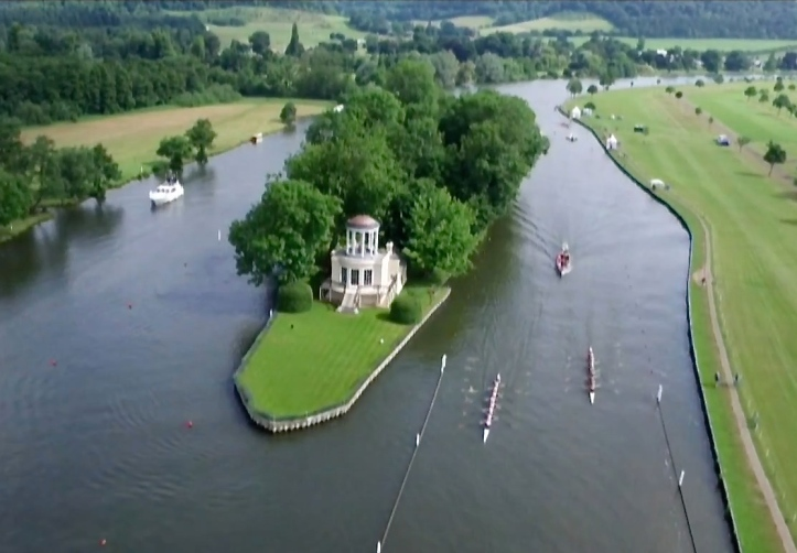 A drone shot of an eights race passing Temple Island. If Hollywood had to design a regatta course, it could do no better. The first 1000 metres of some races are on YouTube (such as this compilation https://www.youtube.com/watch?v=gqIkU_AwfLk ) and contain both pictures from bankside cameras and aerial shots from a drone.