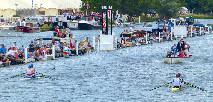 The Double Sculls final in 2015, Thompson and Smith (left) v Collins and Walton (right). Admittedly, the long lens compresses things but the race looks level (or even to the advantage of Thompson and Smith) but the Station 1 / Station 2 indicator board shows that Collins and Walton have a length-and-a-half lead.