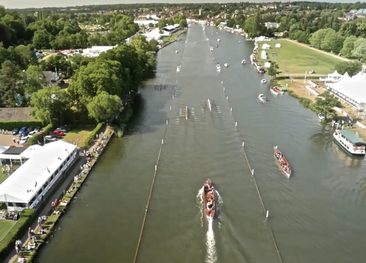 A drone shot of the Oxford Brookes v Nereus race at the 2015 Regatta, looking towards the finish. The race is approaching Fawley Meadows on the right.