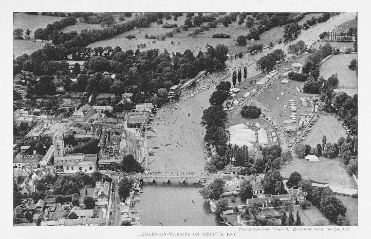 Henley at regatta time, sometime in the very early 1920s. Immediately beyond the bridge on the right bank is Leander Club, then the boat tent area, then (to the left) the Stewards' Enclosure and (to the right) the funfair. To the right of the funfair is the car park (though then much underused).
