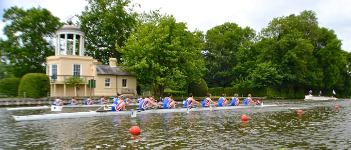 Imperial College and Newcastle University (nearest to the camera) pass the Temple in a semi-final of Senior Eights. IC finished 2 lengths up.