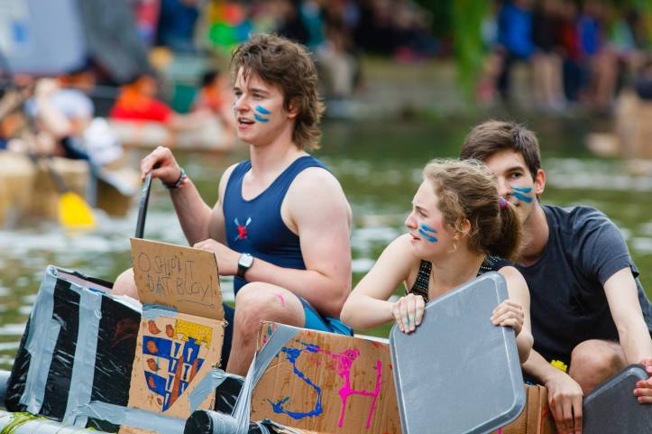 member of PCBC participating in another great Cambridge tradition, the Cardboard Boat Race. Photo Credit: Qty Photography.