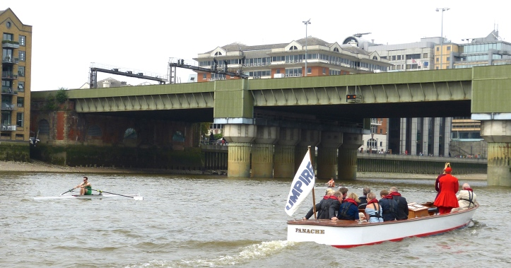 Unfortunate for them, but fortunate for the photographers, the two scullers on the left, Flynn and McCarthy, rapidly fell back leaving the leading three racing alongside each other in a tight and easy to photograph formation. Here Flynn leads McCarthy as they approach the second bridge on the course, Cannon Street bridge, 250 metres in to the 7,400-metre race.