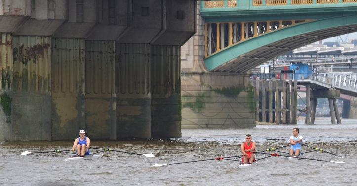 Passing under Cannon Street Bridge, it is Folkard in the lead, then Anderson, then Berry.