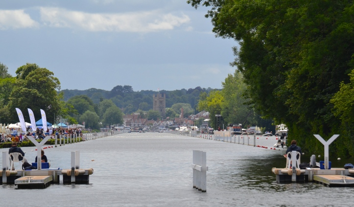 The long camera lens makes Henley's 2,112 metres or 1 mile 550 yards look deceptively short. This traditional length of the course was the longest distance of straight water that could be obtained on the reach in 1839.