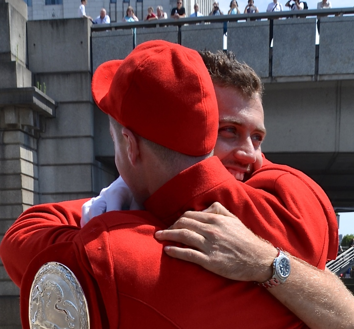Louis Pettipher, who won the Coat and Badge in 2015, embraces Ben Folkard on his return to Fishmongers' Hall after his victory in the 2016 race.