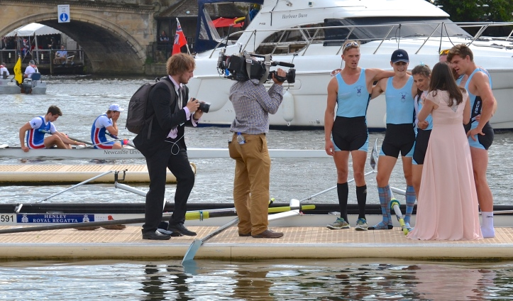 The winning Edinburgh crew get all the attention while, in the background, the losing Newcastle boys suffer alone.