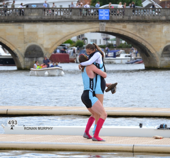 Two ways to treat a winning coxswain. Cox Mareolis gets squeezed and then tossed. You should see what they do to the losers.