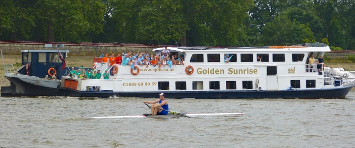 Anderson, now dropped by the umpire, battles to the finish, here passing one of the spectators' boats alongside Battersea Park.