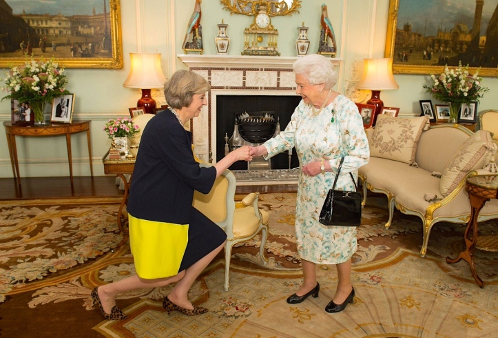 The Queen invites Mrs May to form an administration. At least one of them is saying, 'Actually, I wasn't elected'.