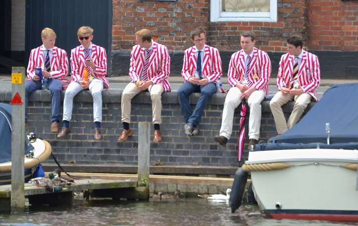 On the town side of the river, boys from Abingdon School take a break from the regatta