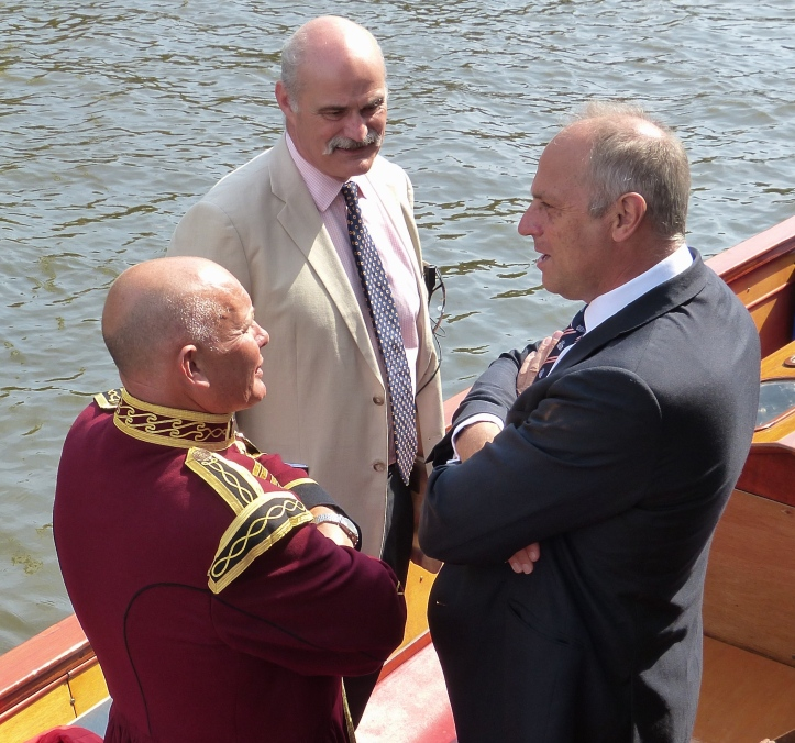 On the umpire's launch, Bobby Prentice, Colin Boag and Steve Redgrave.