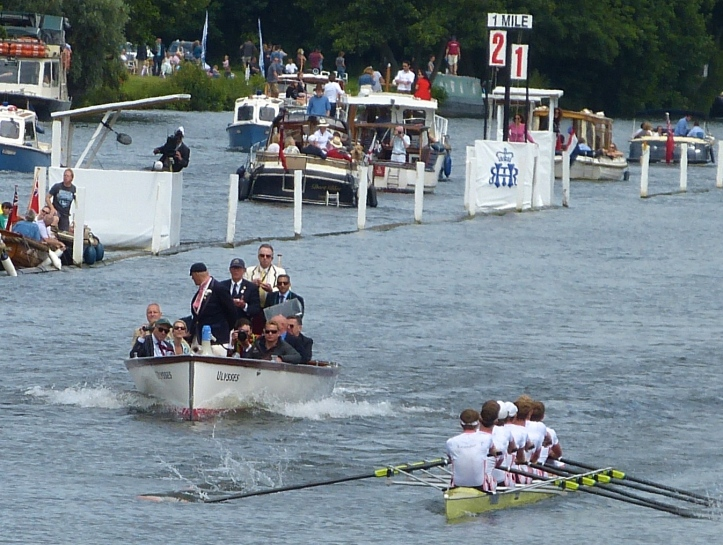A interesting picture from earlier in the race. It does not prove anything but it is unusual for an umpire to take his eyes off the crews. Umpire Rankov seems to be looking at Dutch coach Diederik Simon (in the green baseball cap) who may be gesturing to his boat.