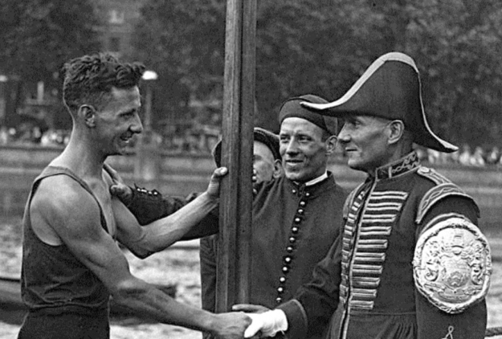 Flashback to 1935: Alfred Gobbett is congratulated by the umpire and Fishmongers' Bargemaster, Harry Phelps.