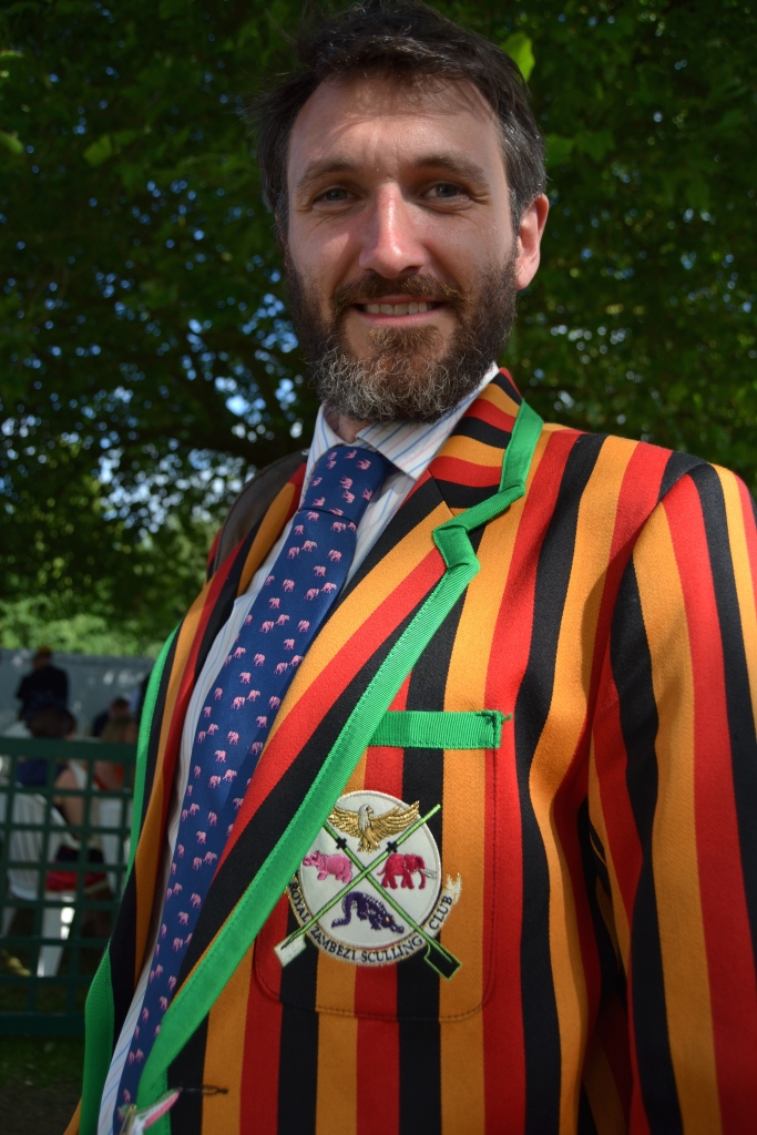 Photographer Hamish Roots. Some great examples of his work, rowing and otherwise, are on his website, lightoverwater.co.uk The site also tells the story behind his 'Royal Zambezi Sculling Club' blazer http://www.lightoverwater.co.uk/news/the-parmigiani-moon-row-2014/ and it shows some of Hamish's wonderful pictures of sculling on the fourth-longest river in Africa.