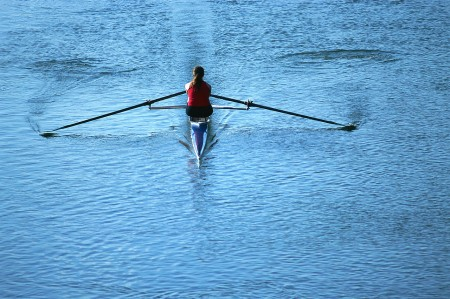 ca. 2001 --- Lone Rower Rowing Boat --- Image by © Royalty-Free/Corbis