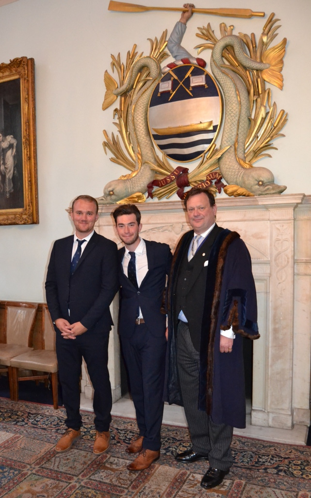 The formal part of the day over, new member of the Company, George McCarthy (centre), poses with cousin Harry (left) and uncle Simon (right). George competed in his first Doggett's a week later, Harry won the Coat and Badge in 2014, Simon (here in the robes of Junior Warden) in 1984 and his brother, Jeremy, in 1992.