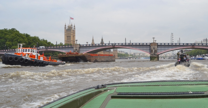 Approaching Lambeth Bridge, a reminder that the Thames is still a working river.