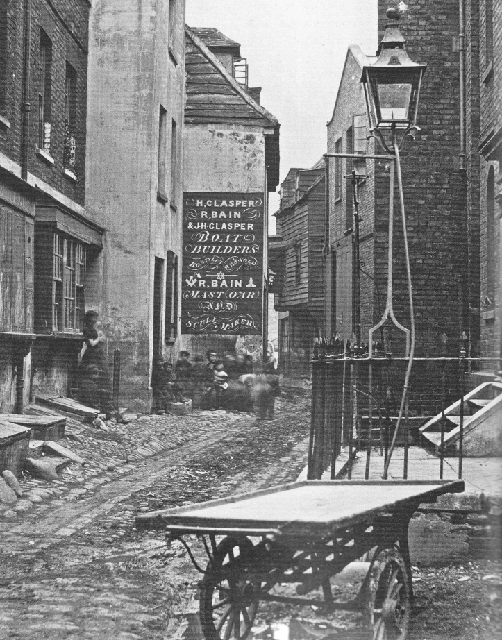 In another 1860s view of Upper Fore Street, the sign shows that 'R Bain' was also in the boat building business with two men having the magic name of 'Clasper'.
