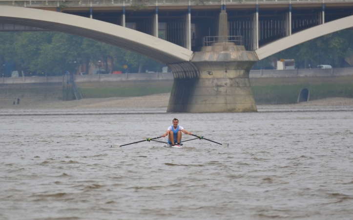 A picture taken during this year's Doggett's. The eventual winner, Ben Folkard, is about to go under Grosvenor Bridge (originally known as Victoria Railway Bridge). On the right, on the north bank, are the grounds of the old soldiers' home, the Royal Hospital Chelsea. In the 18th century this was the site of Ranelagh Gardens.