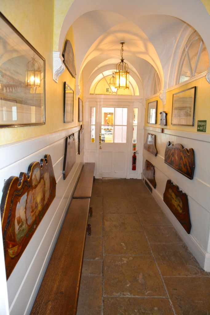 The entrance to Waterman's Hall displaying decorated backboards from Thames Skiffs