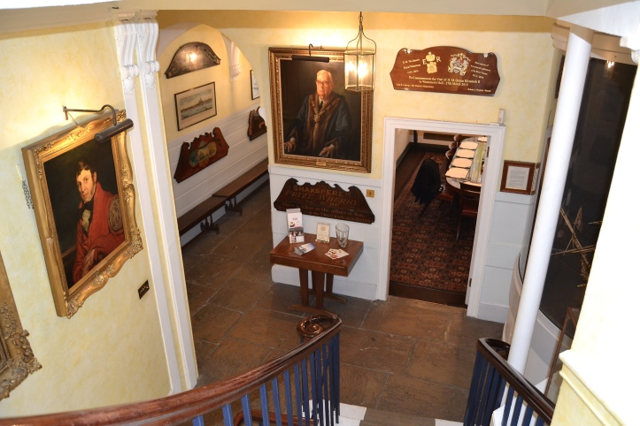 A view of the ground floor from the staircase of Waterman's Hall. The entrance passage is to the left, the 'Parlour' (meeting room) is to the right.