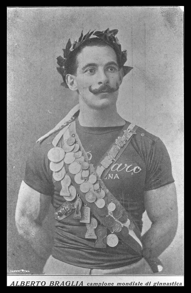 Italian gymnast Alberto Braglia poses proudly with his many medals including two golds from Stockholm. For British 'gentlemen amateurs' at least, such a display would be considered vulgar in the extreme. In those days, Olympic medals were not provided with any sort of loop to hang them by.