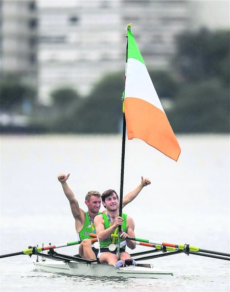 Paul O'Donovan flying the Irish flag after the LM2x Olympic final medal presentation. Gary got to do the same in the Olympic Stadium at the closing ceremony. Photo: Irish Examiner.
