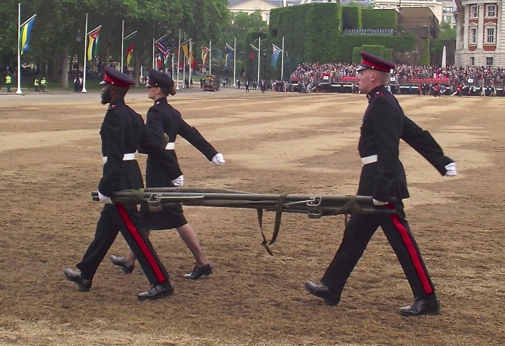 The parade is over and the stretcher party was not required. The day was mild but, on a hot summer, standing and marching in the sun with a large portion of bear balanced on the head can result in fainting in the ranks, much to the delight of photographers. Ideally, a fainting Guardsman will collapse at attention.