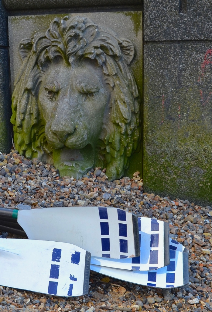 The eights that take part in the Parliamentary Boat Race are launched onto the Thames from next to the Secret Intelligence Services building at Vauxhall Bridge, using a slipway decorated with splendid lion's heads such as this one.