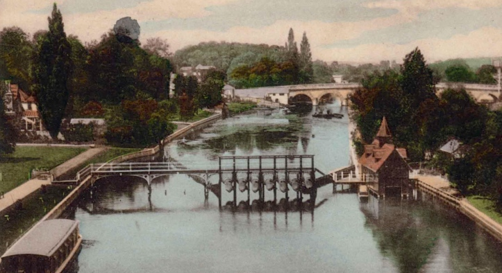 On the left is the club and grounds, on the right is the island and a boathouse with a little spire. The strange devices on the footbridge are eel traps.