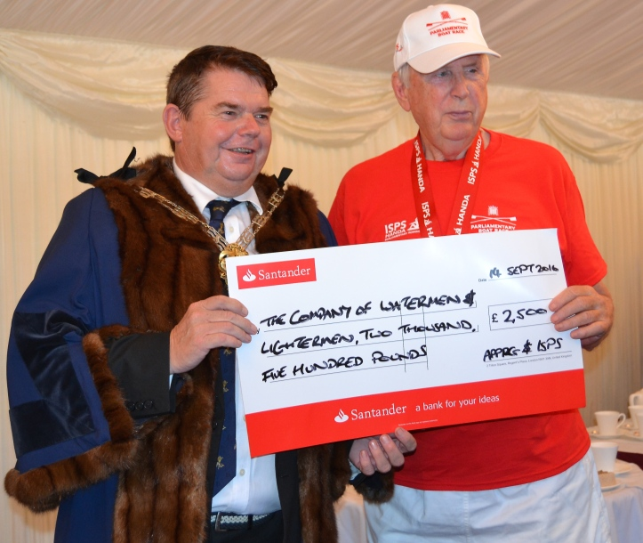 The leader of the Lord's team, Lord Thomas of Gresford (right) presents the Master of the Watermen's Company, John Salter, with a cheque for £2,500 for the Company's charities. A similar amount was given to London Youth Rowing and £5,000 went to the Matt Hampson Foundation, http://matthampsonfoundation.org/ a charity whose aim is 'to provide advice, support, relief and/or treatment for anyone suffering serious injury or disability which has arisen from any cause, but in particular from participation in or training for any sport, sporting activity or other form of physical education or recreation'.