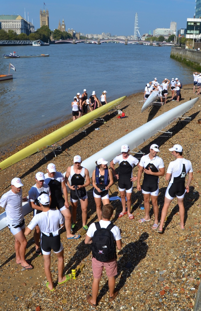 Eights on the foreshore with Lambeth Bridge and Parliament in the background.