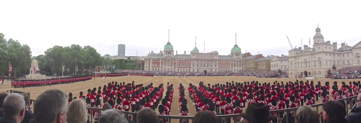 A panoramic view of the parade (click to enlarge). On the far left is the Guards Division War Memorial, https://en.wikipedia.org/wiki/Guards_Memorial in the centre are The Old Admiralty Buildings of 1726 http://britainexplorer.com/listing/old-admiralty-buildings/ and to the right is the Horse Guards building of 1753. For many years, the British Army was run from the latter and the Royal Navy from the former.