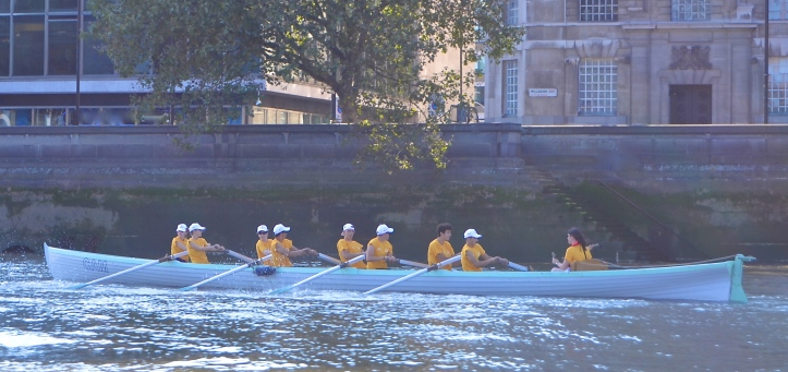 On their way to the start, London Youth Rowing 'Yellow'.