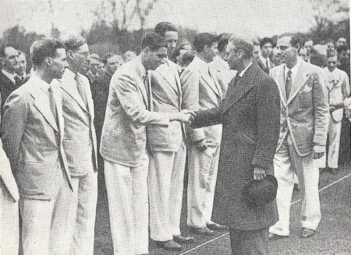 James Crowden shaking hands with His Majesty King George VI at a ceremony at King's College after the Cambridge crew came home from their successful trip to the United States.