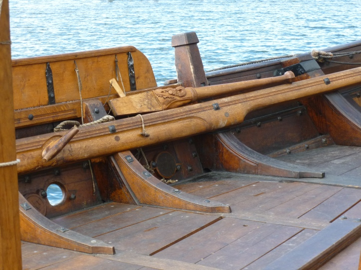 The tiller for the steering oar on starboard side.