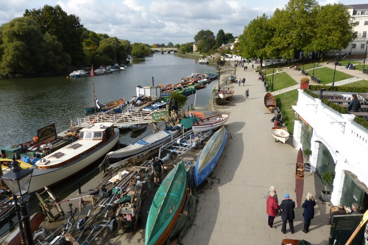 The riverside at Richmond. The majority of the boats here are connected to Mark Edwards, https://en.wikipedia.org/wiki/Mark_Edwards_(boatbuilder) also a builder of traditional wooden boats, though not 'racing boats', which are Bill's speciality. The entrance to Bill's workshop is in the bottom right of the picture.