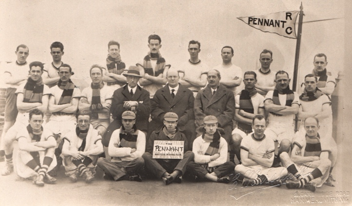The Pennant Amateur Rowing Club, probably in the 1930s. The photographer is from Hammersmith, West London. I have particular knowledge of the history of rowing in this area – but can find nothing about this club. Something for the HTBS irregulars to research?
