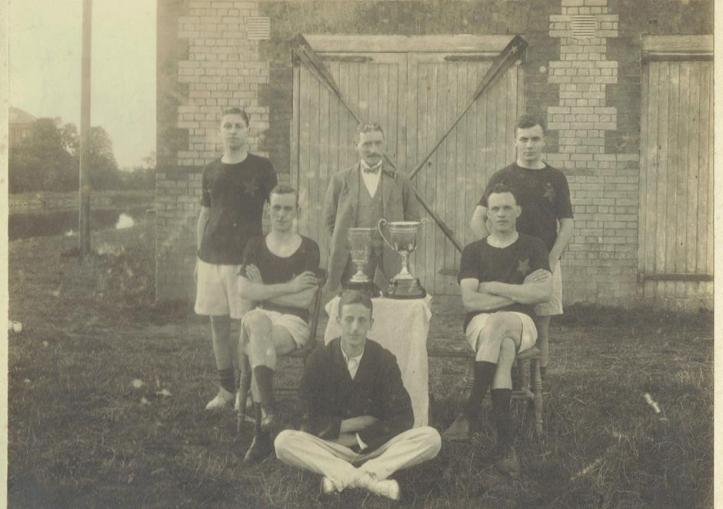 Stars of the County Down – A coxed four and coach pictured outside the club's boathouse on the Newry Canal. Rowers named as H. J. McConville, Joseph Fisher, Joe Dunlop and W. A. Magowan. The coach could be the same person pictured at five seat in the previous photograph who in turn may be G. T. Allen.