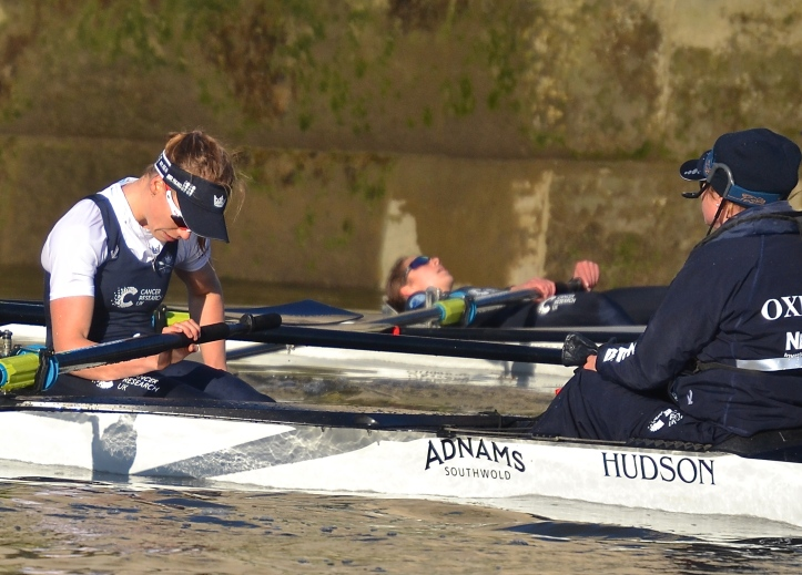"Recovering under Chiswick Bridge, ""Heather"" stroke, Flo Pickles, and her cox, Clarissa Coveney. In the background is ""Helen""'s bow, Lise Du Buisson. In a race with no real losers, new coach Ali Williams will have a lot to think about."