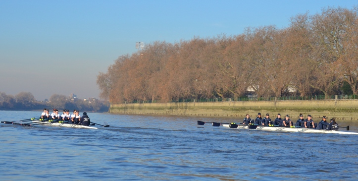 """Heather"" (left) leads ""Helen"" along Putney Embankment. As mentioned in the report on the men's race, the photographic parallax error makes the crew nearer the camera look further ahead than it actually was."