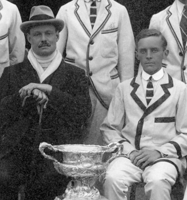 Steve Fairbairn (on the left) and Herbert L. Holman. The top of the Grand Challenge Cup trophy can be seen at the bottom of the image. Courtesy of Thames RC.