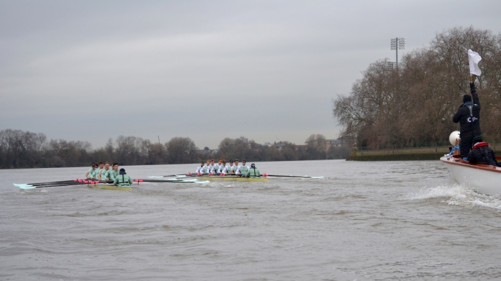 "The race at the end of Putney Embankment. On the left (Surrey) is ""Two Gs"" stroked by Freddie Davidson and coxed by three times Boat Race veteran, Ian Middleton. On the right (Middlesex) is ""One T"", stroked by Henry Meek and coxed by Hugo Ramambason. Full crew lists are here http://theboatraces.org/news-article/292/cambridge-trial-eights and crew biographies are here. http://theboatraces.org/cubc"
