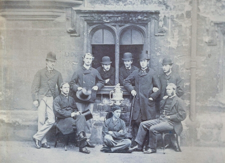 The triumphant if controversial 1865 Head of the River Eight. Standing from left: J. Rickaby, W.B. Woodgate, A. Shepherd, A.J. Richards, S.R. Coxe, R.F. Rumsey. Seated from left: P.A. Latham, C. Thompson, S.E. Illingworth.